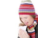Mujer de estornudo con el pañuelo Fotografía de archivo