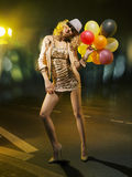 Mujer de fascinación rubia con los globos Foto de archivo libre de regalías