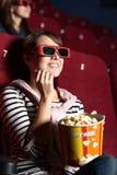 Mujer de Joyfull en el cine Fotografía de archivo libre de regalías