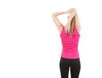 Mujer de la aptitud que estira sus hombros imagen de archivo