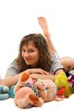 Mujer de la belleza con los juguetes Foto de archivo