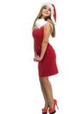 Mujer de la belleza en el sombrero rojo de santa Imagenes de archivo