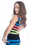 Mujer de la belleza en vestido coloreado de la raya Imagen de archivo libre de regalías