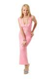 Mujer de la belleza en vestido de noche rosado. Fotos de archivo libres de regalías