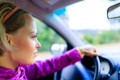 Mujer de la conducción de automóviles Fotos de archivo libres de regalías
