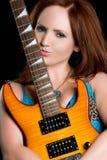 Mujer de la guitarra eléctrica Foto de archivo libre de regalías