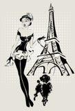 Mujer de la moda del ejemplo cerca de la torre Eiffel con el pequeño perro Imagen de archivo