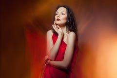 Mujer de la moda en el fuego Imágenes de archivo libres de regalías