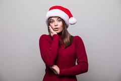 Mujer de la Navidad con el sombrero de santa Imagen de archivo
