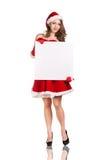 Mujer de la Navidad en el sombrero de Santa Claus Imagenes de archivo
