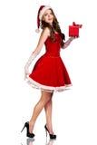 Mujer de la Navidad en el sombrero de Santa Claus Fotografía de archivo