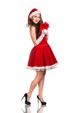 Mujer de la Navidad en el sombrero de Santa Claus Foto de archivo libre de regalías