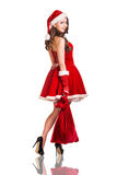 Mujer de la Navidad en el sombrero de Santa Claus Imagen de archivo