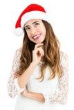 Mujer de la Navidad que mira para copiar el espacio Foto de archivo libre de regalías
