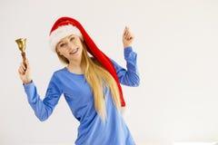 Mujer de la Navidad que sostiene la campana Fotos de archivo
