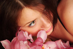 Mujer de la orquídea Foto de archivo libre de regalías