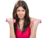Mujer de la pérdida de peso que se resuelve en gimnasia de la aptitud Fotografía de archivo libre de regalías