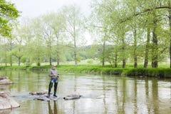 Mujer de la pesca Fotos de archivo libres de regalías