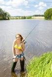 Mujer de la pesca Imagenes de archivo