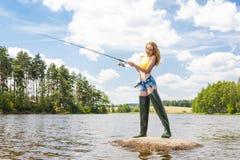 Mujer de la pesca Foto de archivo libre de regalías