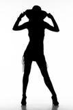 Mujer de la silueta con un sunhat imagen de archivo