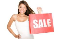 Mujer de la venta de los bolsos de compras Imagen de archivo