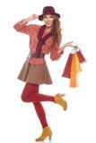 Mujer de las compras que sostiene bolsos, foto de archivo