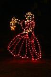Mujer de las luces de la Navidad fotografía de archivo libre de regalías
