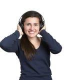 Mujer de los auriculares Foto de archivo libre de regalías