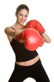 Mujer de los guantes de boxeo Fotografía de archivo libre de regalías