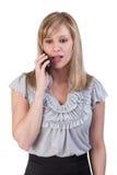 Mujer de mirada en cuestión con el teléfono celular Fotografía de archivo libre de regalías