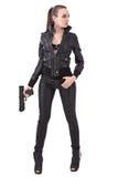 Mujer de moda con un arma Imagen de archivo