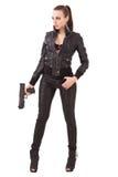 Mujer de moda con una pistola Fotografía de archivo libre de regalías