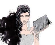 Mujer de moda, elegante con un bolso en manos Foto de archivo libre de regalías