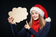 Mujer de Navidad con la burbuja del pensamiento Imagen de archivo libre de regalías