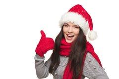 Mujer de Navidad que muestra el pulgar para arriba foto de archivo