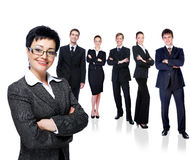 Mujer de negocios acertada con grupo de trabajo Fotos de archivo libres de regalías
