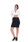 Mujer de negocios acertada joven sonriente aislada Imagenes de archivo