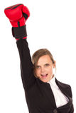 Mujer de negocios acertada que celebra con un brazo en wearin del aire Foto de archivo libre de regalías