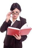 Mujer de negocios acertada que controla su agenda Foto de archivo libre de regalías