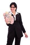 Mujer de negocios acertada que muestra billetes de banco Foto de archivo libre de regalías