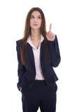Mujer de negocios aislada que presenta con su finger sobre los vagos blancos Fotografía de archivo libre de regalías