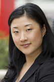 Mujer de negocios asiática atractiva Foto de archivo