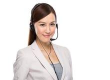Mujer de negocios asiática con el auricular Foto de archivo