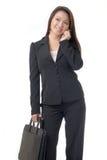 Mujer de negocios asiática en el teléfono celular Imágenes de archivo libres de regalías