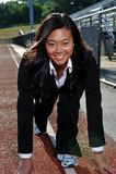Mujer de negocios asiática lista para comenzar la raza - Imagen de archivo libre de regalías