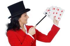 Mujer de negocios atractiva con una varita y un sombrero mágicos Imagenes de archivo