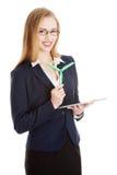 Mujer de negocios caucásica hermosa que sostiene el molino de viento y la tableta. Imagenes de archivo