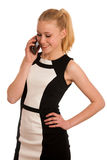 Mujer de negocios caucásica joven hermosa con communi del smartphone Foto de archivo libre de regalías