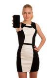 Mujer de negocios caucásica joven hermosa con communi del smartphone Imágenes de archivo libres de regalías